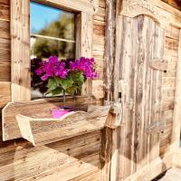 Fenêtre fixe avec une jardinière vieux bois et porte prestige (en options)